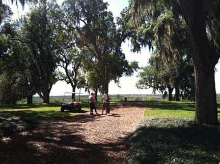Visitors enjoy tower grounds  overlooking Lake Wales surrounding area below