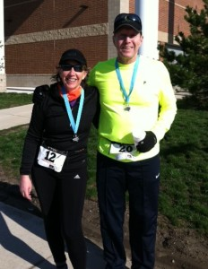 Guess which one of us has had a few minutes to recuperate? Hint: The one who doesn't look ready to fall over. Me and the hubby, right after I crossed the finish line.