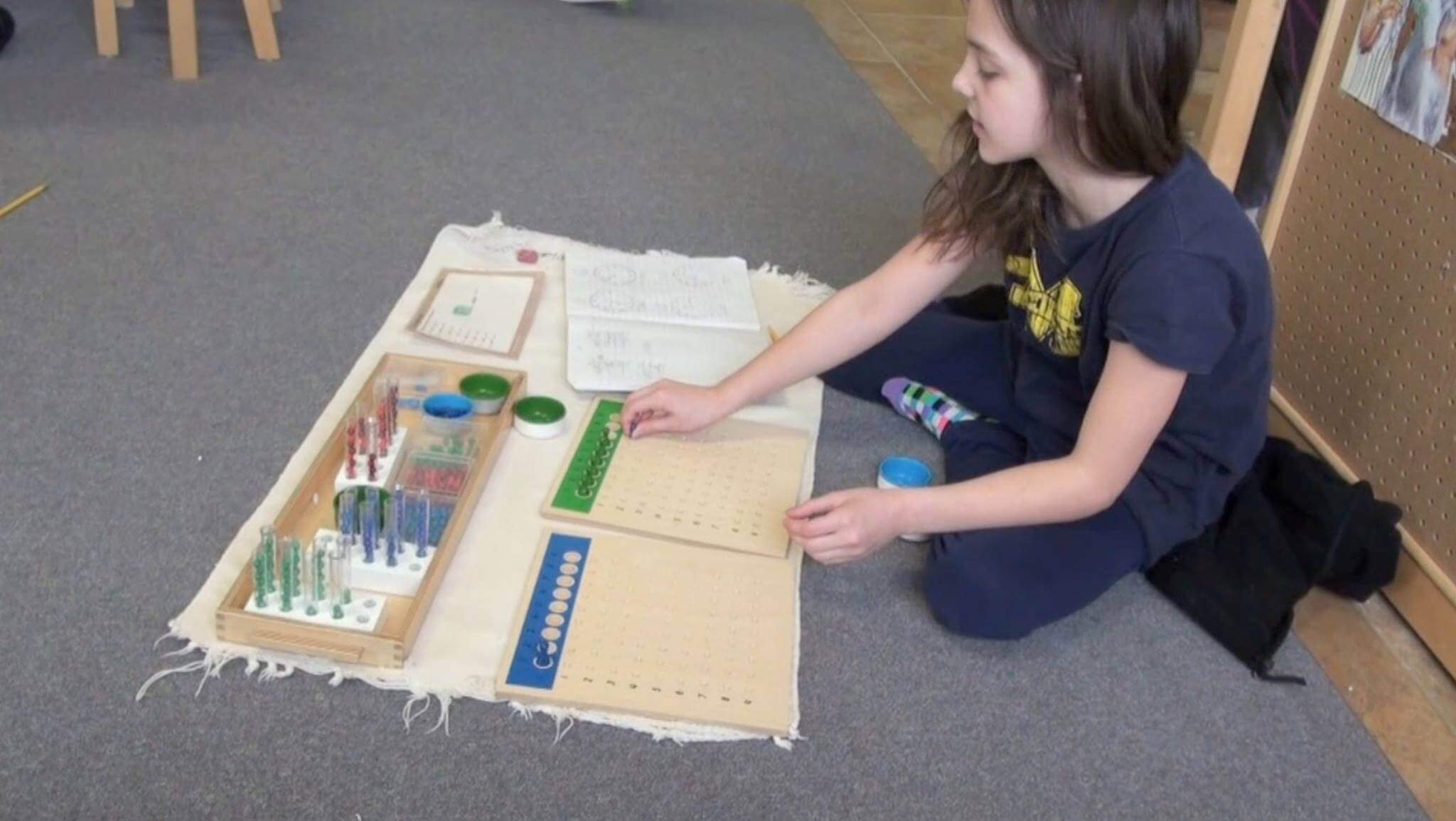 A student works on a project at Light of the World Academy, which will open this fall as a tuition-free Montessori public charter school in Pinckney.