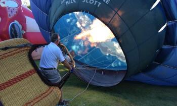 Pilot Scott Lorenz finishes filling the balloon