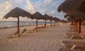 Serenity of ocean sunrise on Cancun seashore