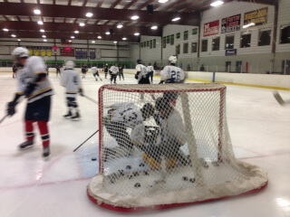 Hartland players clear pucks out of the net before a November workout. The Eagles downed Sault St.e Marie, 3-1, on Saturday. (File photo by Tim Robinson)
