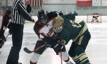 Brighton's Jake Krespi (24) and Howell's Russ Daavettila battle for the puck in a second-period face-off Wednesday night. (Photo by Taylor Vecchioni)
