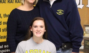 Maggie Mitter poses with her parents Wednesday.