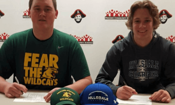 Pinckney seniors Bryce Heatwole, left, and Joey Bachmeier signed with Northern Michigan and Hillsdale on Wednesday,