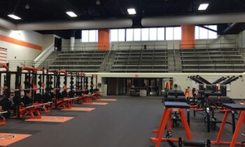 A look from the north end of the new Brighton weight facility shows the bleachers preserved from the room's previous use, as the Brighton High School pool. (Photo by Tim Robinson)