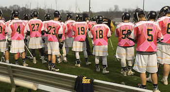 Hartland's boys lacrosse team wore pink uniforms for breast cancer awareness during Wednesday's game. (Photo by Tim Robinson)