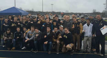 The Hartland wrestling team poses with its championship rings during halftime of the boys lacrosse game at Hartland High School on Wednesday night. (Photo by Tim Robinson)