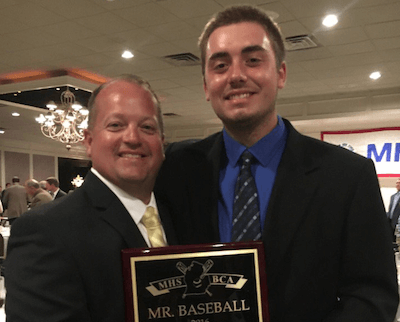Hartland baseball coach Brian Morrison, left, and John Baker pose with the Mr. Baseball trophy on Tuesday. Baker is the first Hartland player to earn the award, which he shared with Portage Northern's Tommy Henry.