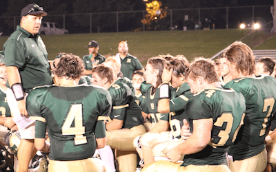 Howell coach Aaron Metz talks to his team after it won its 2016 season opener on Thursday, The Highlanders defeated Lansing Everett 18-12. (Photo by Tim Robinson)