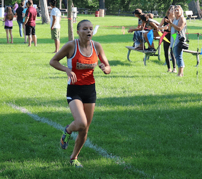 Andrea Crowe had the best finish for Brighton, placing third as the Bulldogs nipped Milford by a point on Tuesday. (Photo by Tim Robinson)
