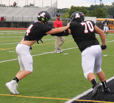 Wes Smith (4) and Adam Sieler were key players on a Pinckney defense that held Franklin's offense mostly in check until the fourth quarter. (Photo by Tim Robinson)