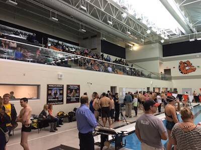 Former Brighton swimmers and swim parents packed the high school pool Wednesday in a meet that was a memorial for a former coach, Tim McInnis, who died in September. (Photo by Tim Robinson)
