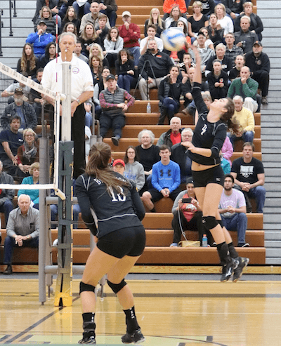 Brighton's Celia Cullen goes up for a spike as Gabrielle Tschannen looks on during Tuesday's match. Cullen had 13 kills and nine assists in a losing effort. (Photo by Tim Robinson)