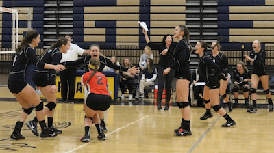 Brighton players and coaches celebrate after winning Wednesday's district semifinal match with Hartland. The Bulldogs take on South Lyon on Friday for the district title. (Photo by Tim Robinson)