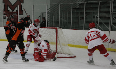 Brighton's Mathew Kahra (22) celebrates after Adam Conquest put the Bulldogs ahead 2-1 midway through the second period. (Photo by Tim Robinson)