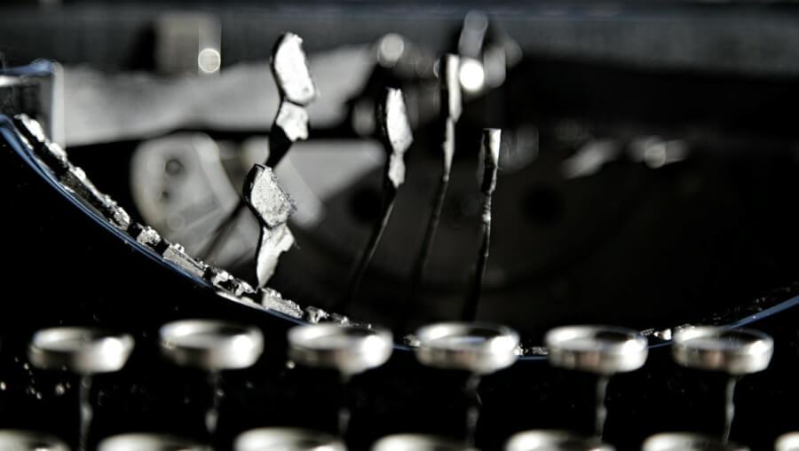 Closeup photo on black vintage typewriter.