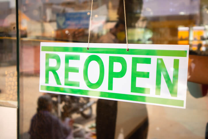 Reopen Signage board in front of Businesses or store door after covid-19 or coronavirus crisis- Concept of back to business after lockdown.